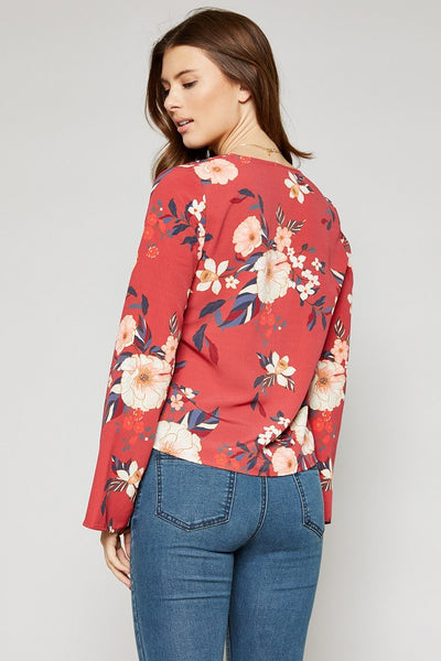 womans top with flowers