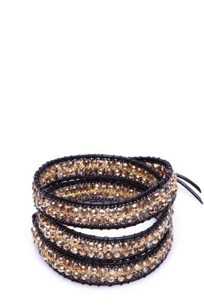 black wrap bracelet with gold gemstones