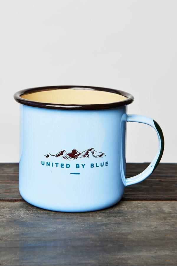 blue enamel mug with mountain theme