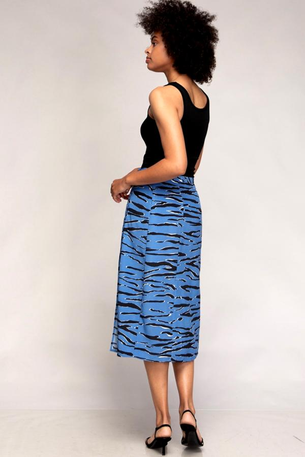 black woman wearing blue midi skirt and black tank top