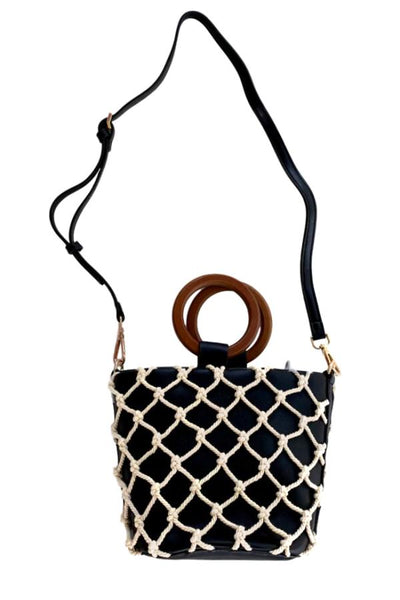 black bag with wood handles and white netting