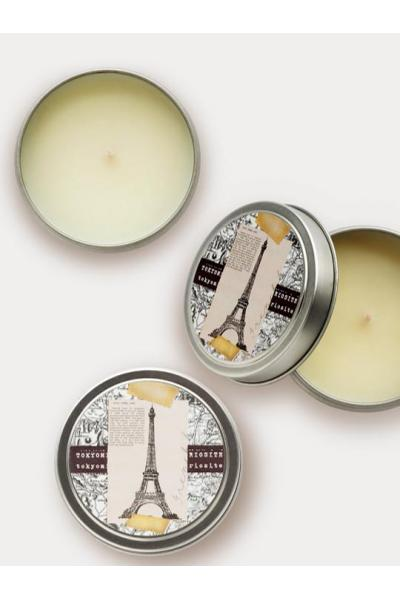 two travel candles with opened lids