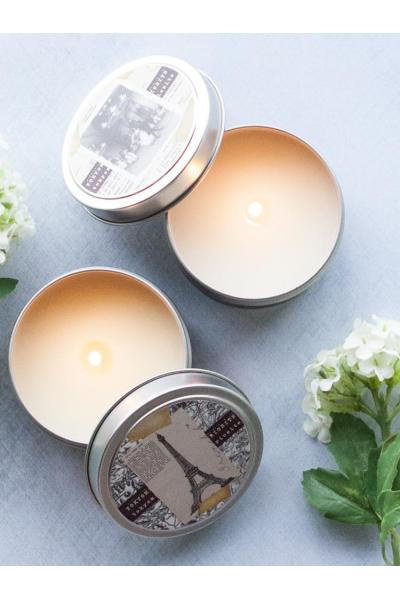 two travel candles with flower