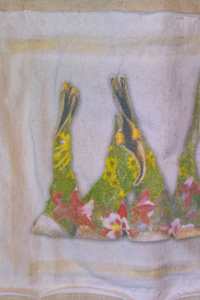 detail of cowboy boots on kitchen towel