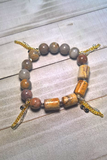 gemstone stretch bracelet with gold tassels