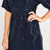 detail of woman wearing a navy sequin dress