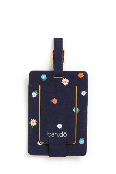 navy luggage tag with little blue pink and red flowers
