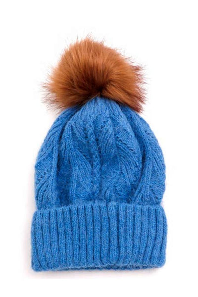 blue women's hat with a pompom