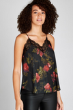 woman wearing a floral camisole with lace trim