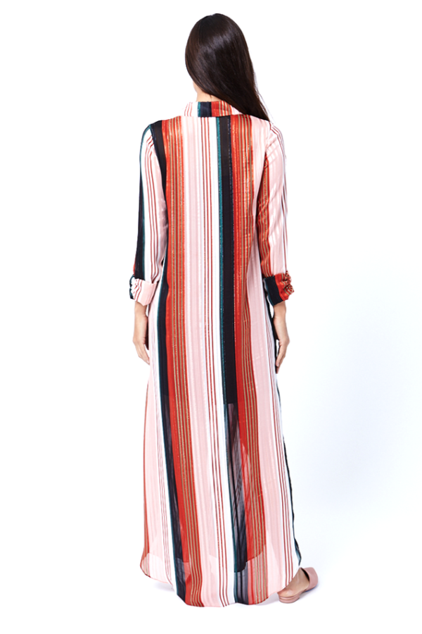 woman wearing a red and black striped maxi dress
