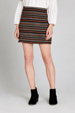 textured mini skirt and black ankle boots