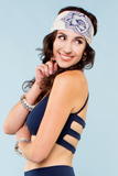 woman wearing navy strappy bralette and a headband