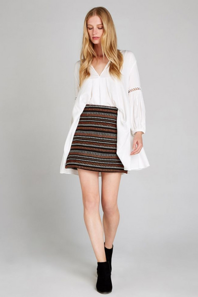 warm mini skirt and white blouse boho outfit