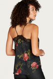 women's back detail wearing a strappy floral camisole