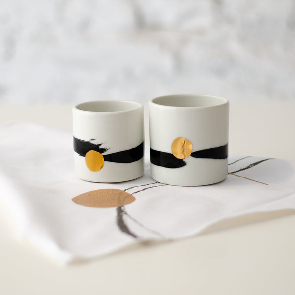 Cappucinno minimalistic cup, white with black brush stroke and golden dot