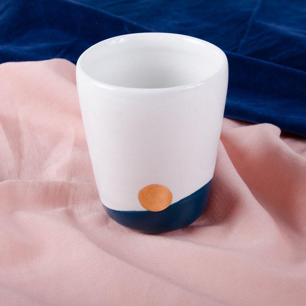Porcelain mug, white with a Majolica Blue bottom and a golden dot