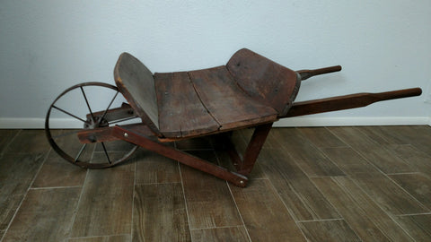 Antique wood wheelbarrow