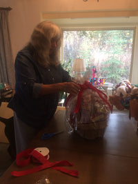 Finishing a basket to donate for silent auction to non profit animal/rescue group.