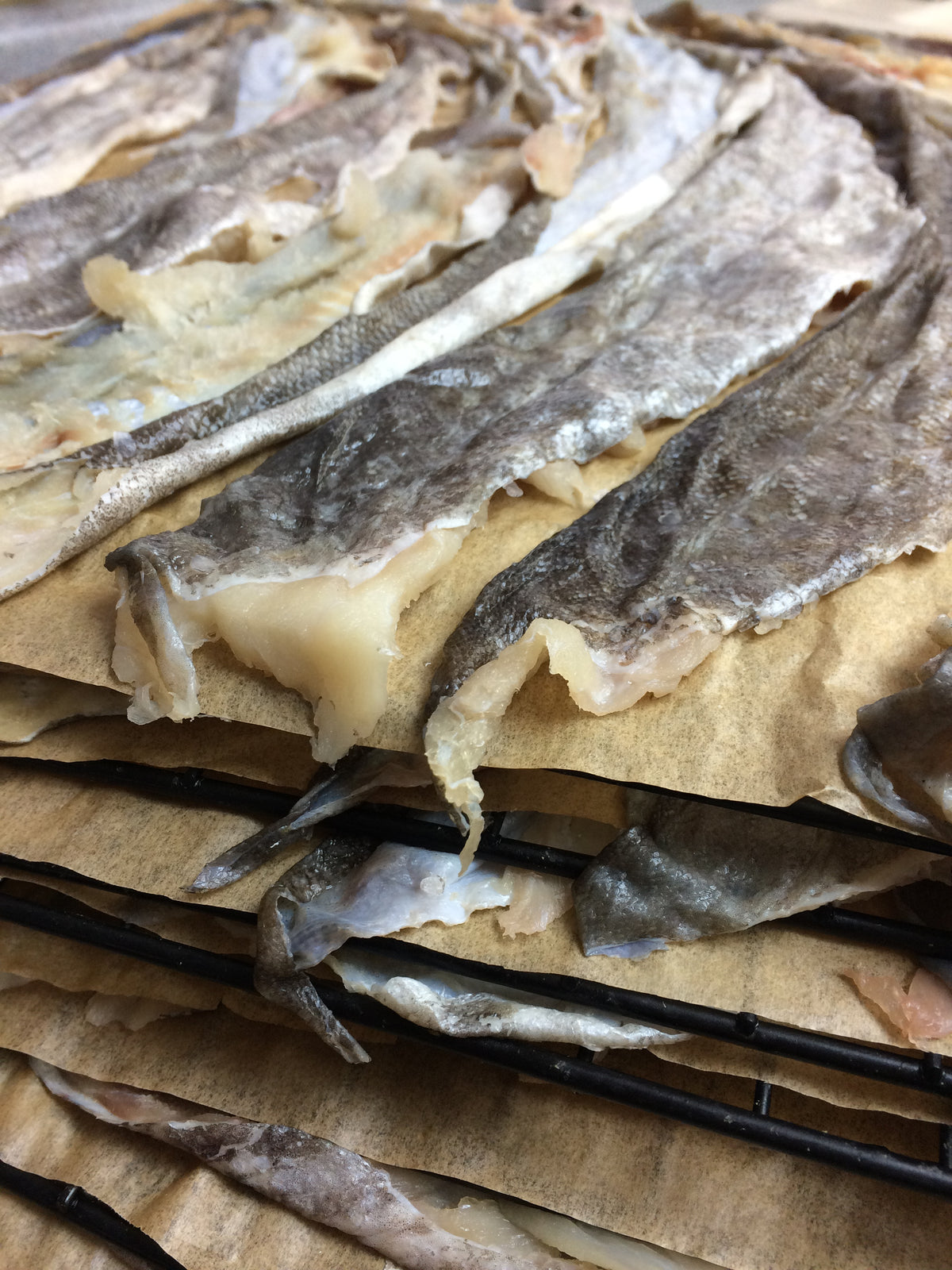 Laid out fresh wild Alaska cod skins for drying.