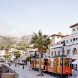 Port de Soller promenade with tram driving past