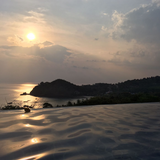Sunset view from infinity pool overlooking the sea on Koh Lanta island