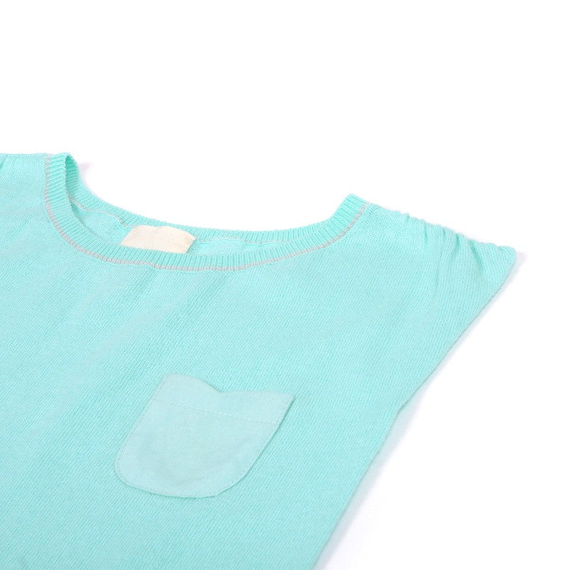 Close up view of front breast pocket on aqua fairy cotton dress