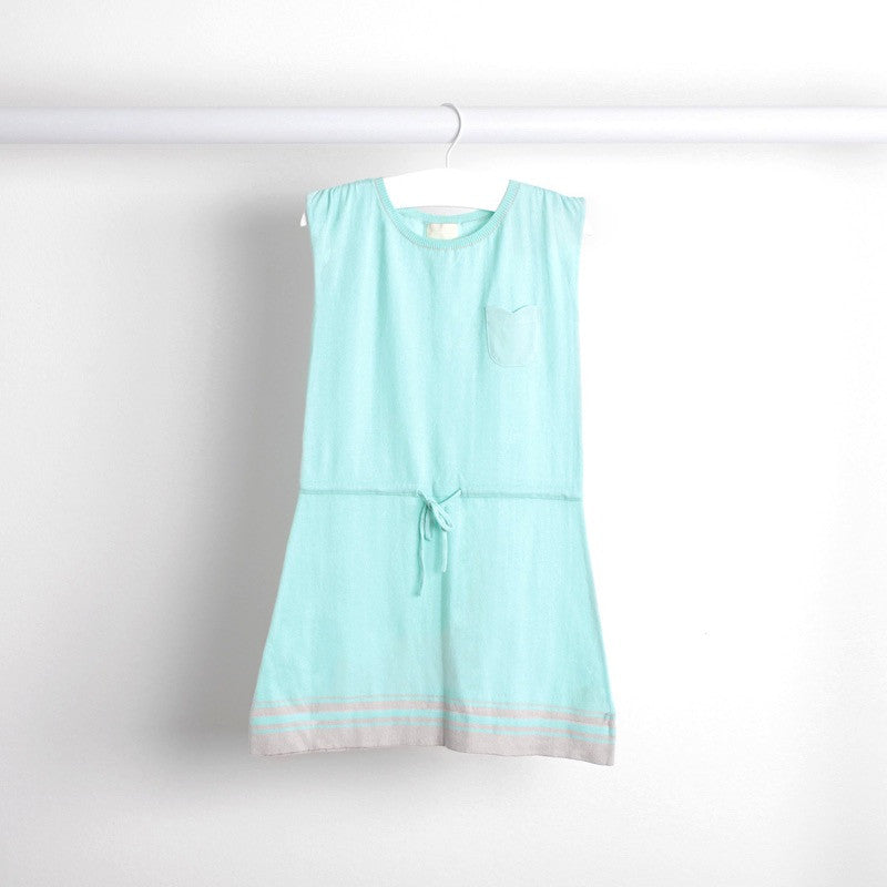 Hanging image of floaty cotton dress with waistband tie. Pastel aqua with grey stripe detail at hem and floral shaped pocket at front.