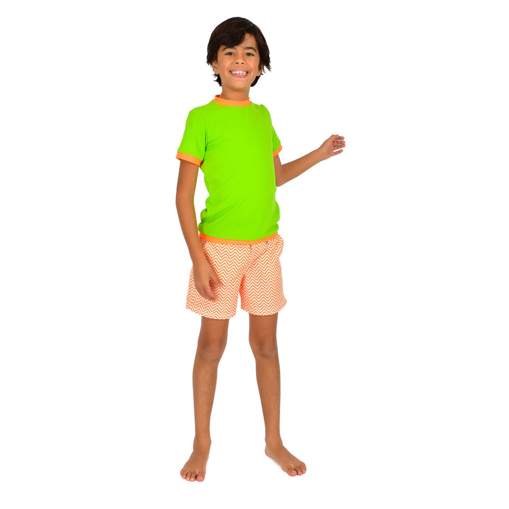 Front view of boy wearing neon green rash vest. Short sleeve with contrast orange trim