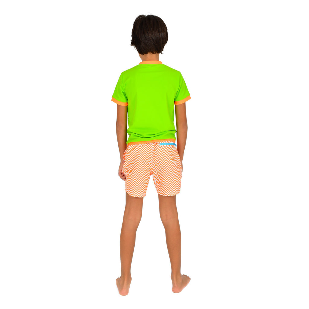 Back view of boy wearing neon green rash vest. Short sleeve with contrast orange trim