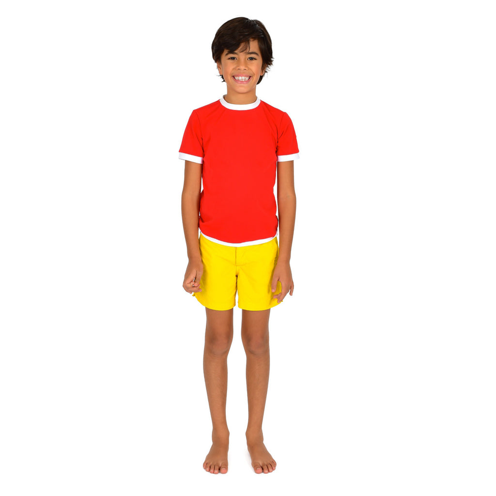 Front view of boy wearing bright red rash vest. Short sleeve with contrast white trim