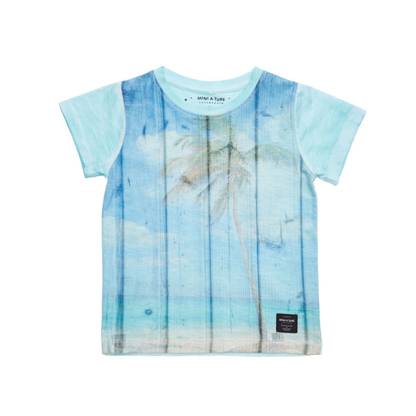 Pale blue t-shirt with retro beach and palm print. Washed-look finish in soft cotton mix