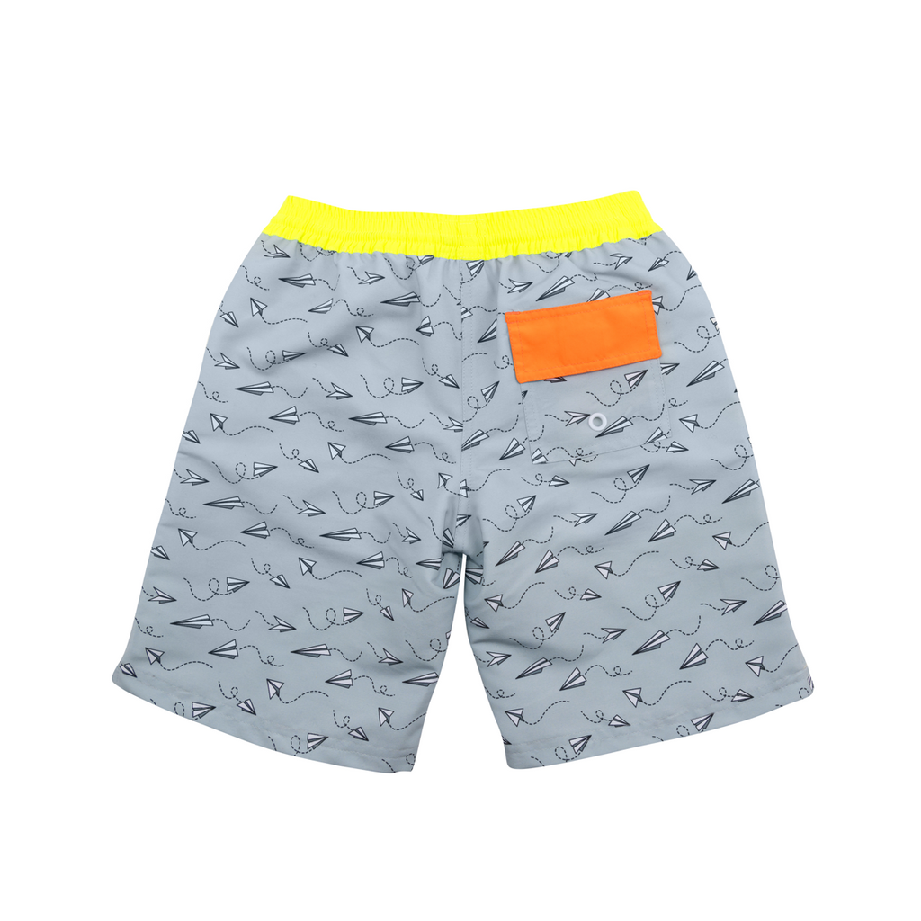 Back view of grey tailored swim shorts with fun flying paper planes print. Adjustable waist with contrast neon yellow waistband and neon orange back pocket. Side pockets and lightning bolt tag detail.