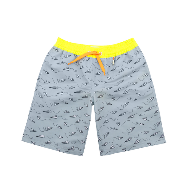 Front view of grey tailored swim shorts with fun flying paper planes print. Contrast neon yellow waistband with neon orange tie fastening. Side pockets and lightning bolt tag detail
