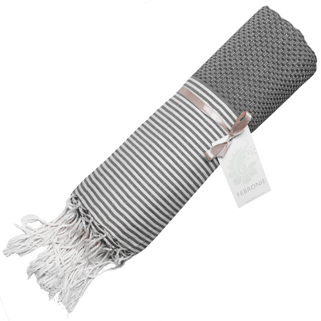 Rolled cotton hammam towel with honeycomb weave in mid-grey colour with grey/white stripe detail and tassel ends