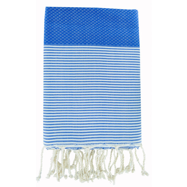 Folded cotton hammam towel with honeycomb weave in striking mid-blue colour with blue/white stripe detail and tassel ends