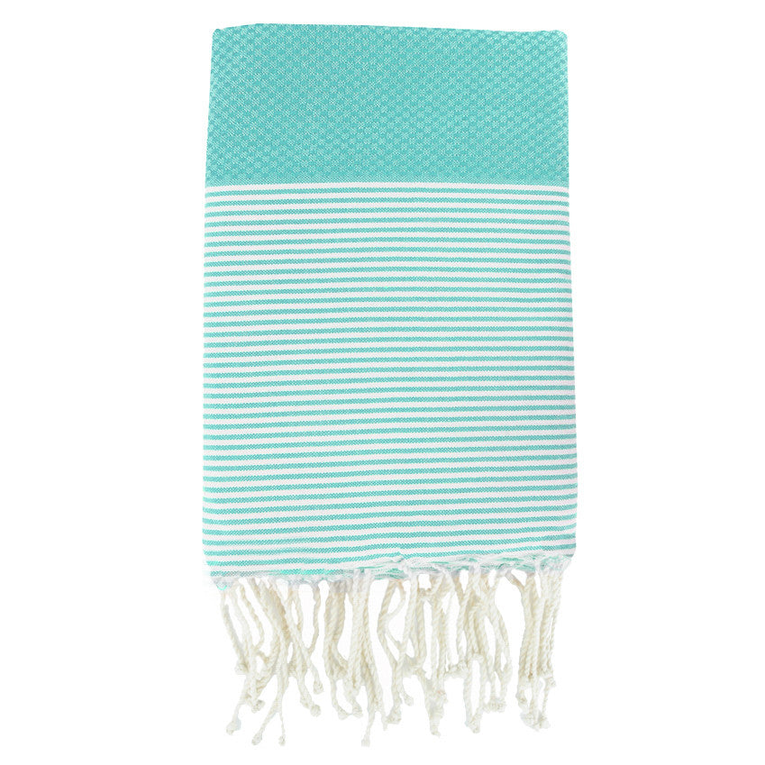 Folded cotton hammam towel with honeycomb weave in bold aqua colour with aqua/white stripe detail and tassel ends