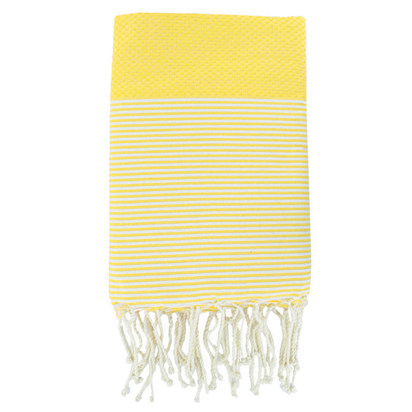 Folded cotton hammam towel with honeycomb weave in striking yellow colour with yellow/white stripe detail and tassel ends