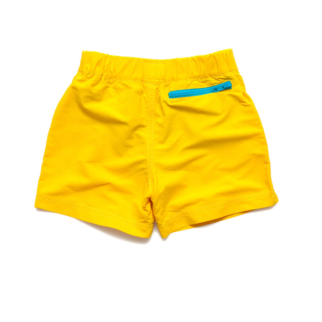 Back view of bright yellow tailored swim shorts with contrast zip detail. Adjustable waist, side pockets, quick drying fabric