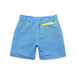 Back view of blue geometric cube pattern boys swim shorts. Zip pocket detail in contrast neon yellow