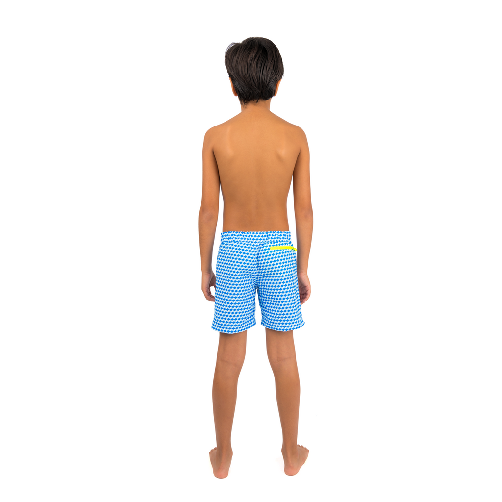 Back view of boy wearing blue geometric cube pattern boys swim shorts.