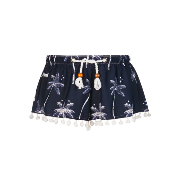 Navy and white palm print shorts with white tassel detail along hem and string tie waist. Perfect for post-swim cover up. UV50+ protection