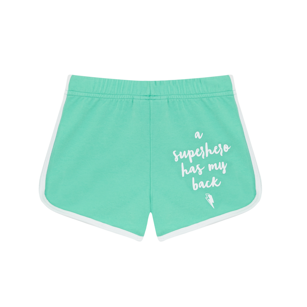 Back view of cool kid bright green retro style shorts in super soft cotton. 'A superhero has my back' slogan printed on reverse