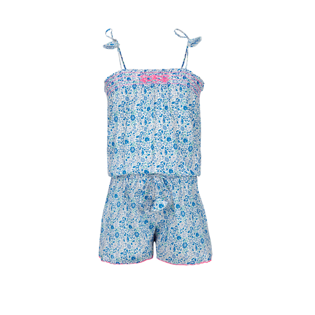 Liberty print playsuit in lightweight soft cotton. Beautiful mix of blues with contrast pink trim detail. Tie straps to waist and on shoulder straps