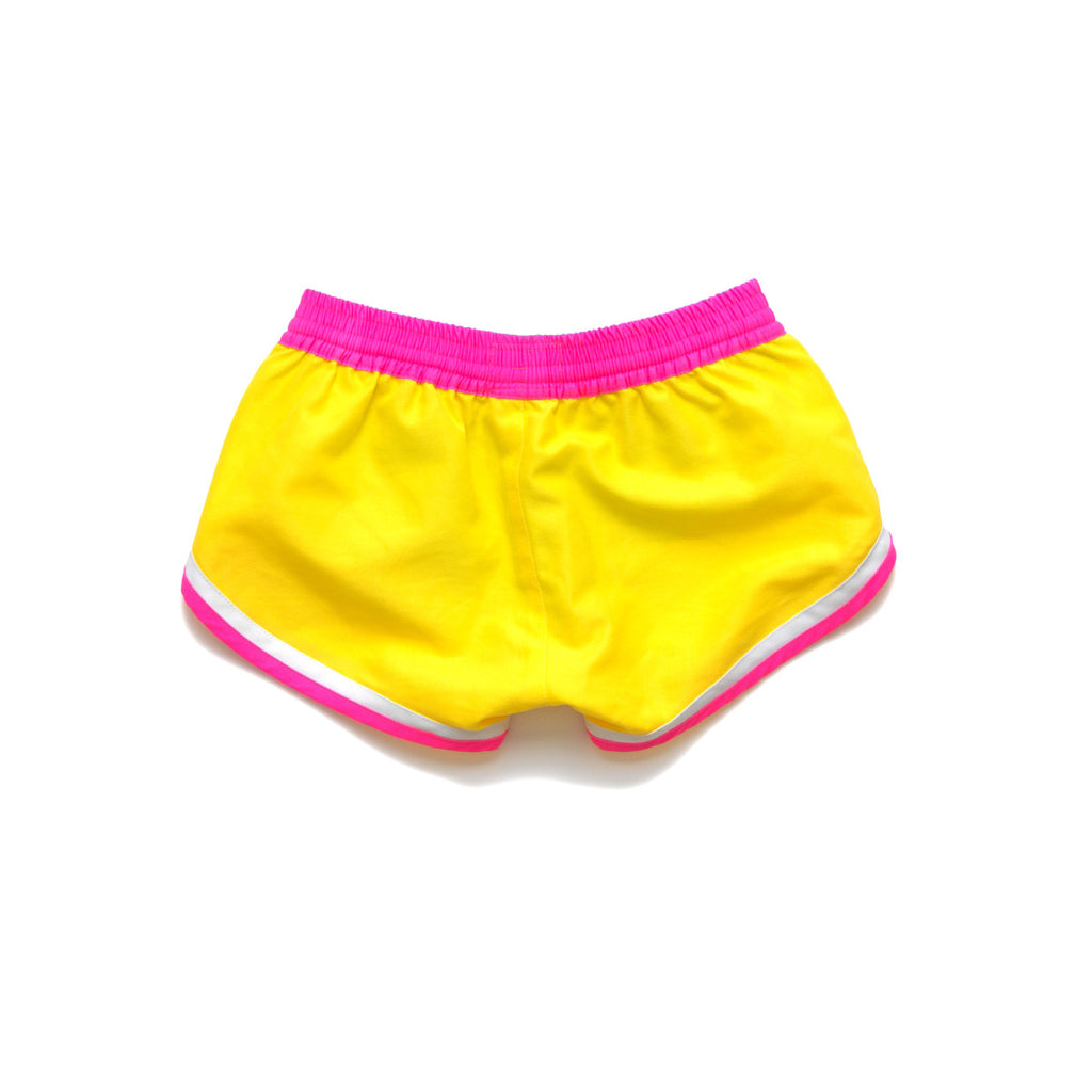 Back view of funky boxer-style elasticated shorts with pockets. Vibrant sunshine yellow with contrast bright pink waistband, trim and tie