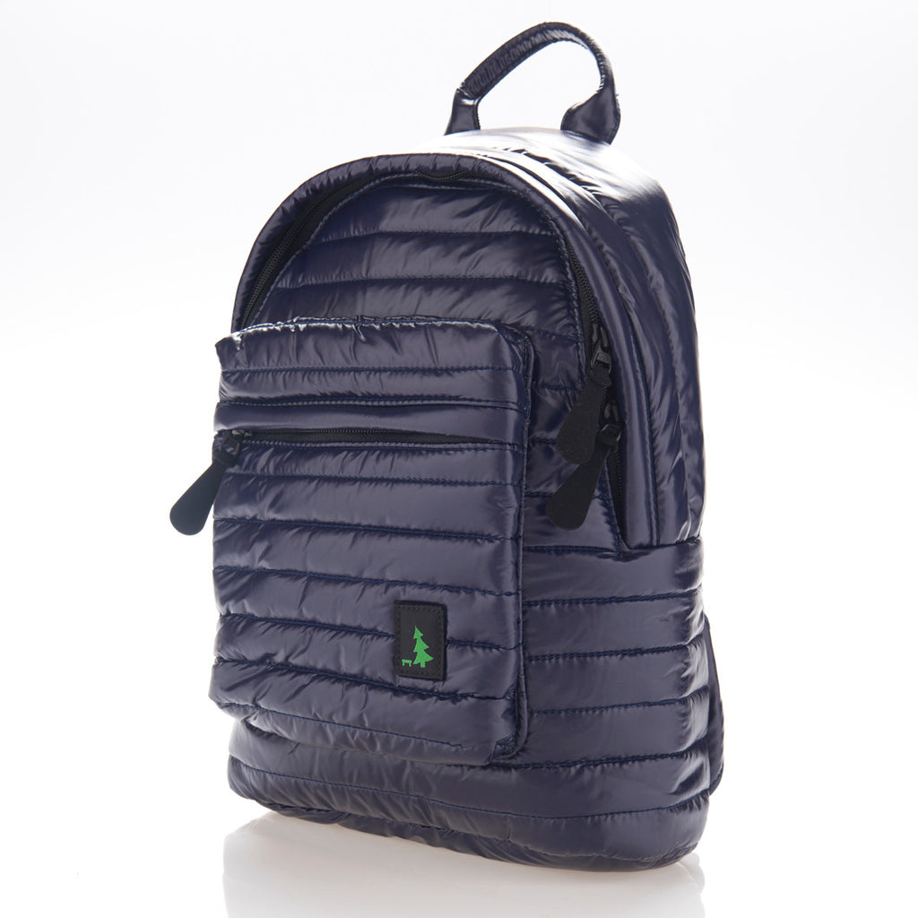 Angle front view of navy blue small backpack. Made from durable shiny nylon puffer material with quality components. Large main section and small front pocket