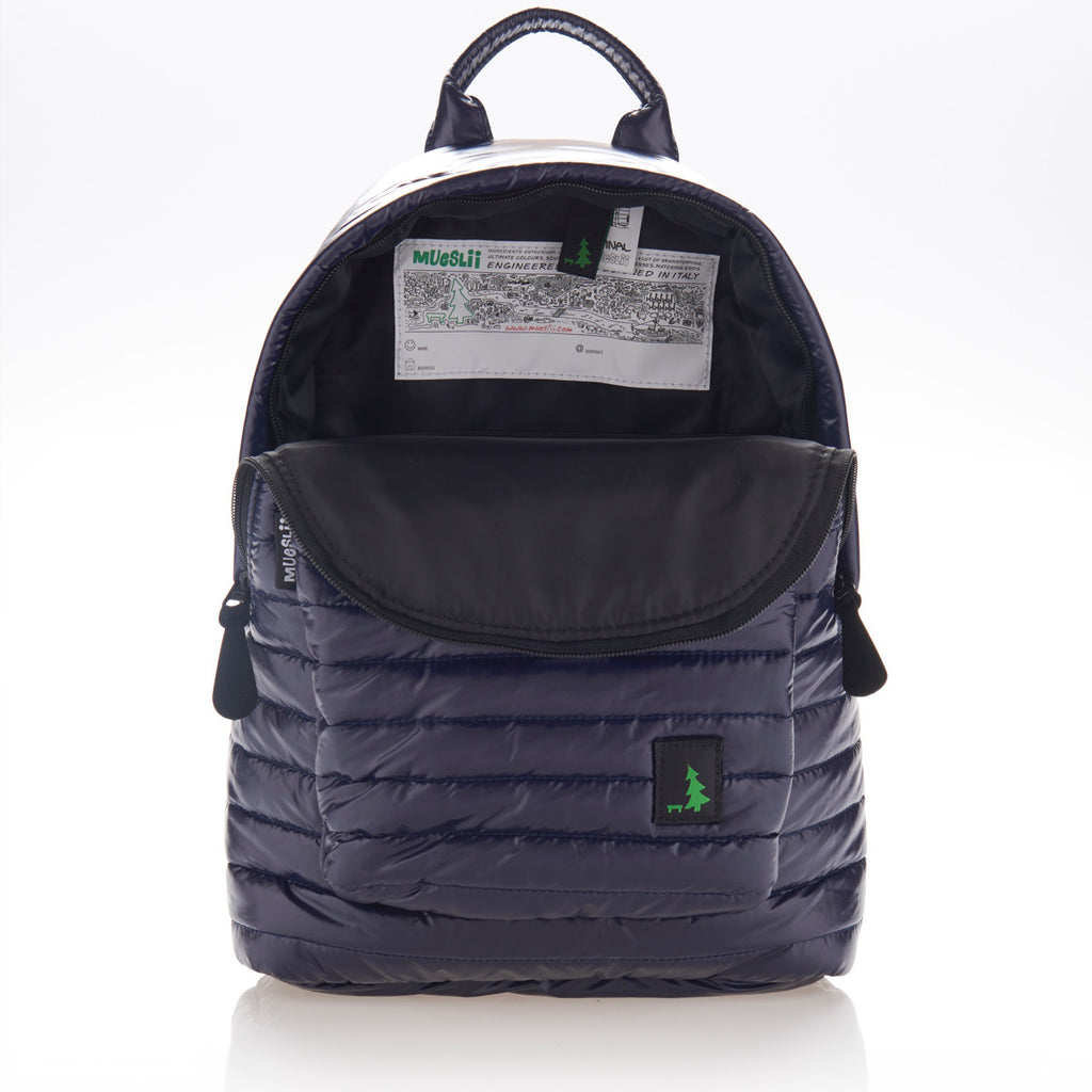 Inside view of large pocket of navy blue small backpack. Made from durable shiny nylon puffer material with quality components. Black lining.