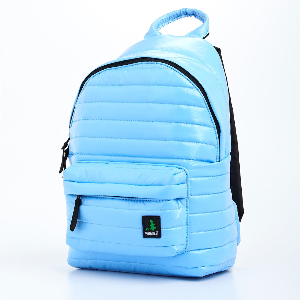 Angle side view of light blue small backpack. Made from durable shiny nylon puffer material with quality components. Large main section and small front pocket