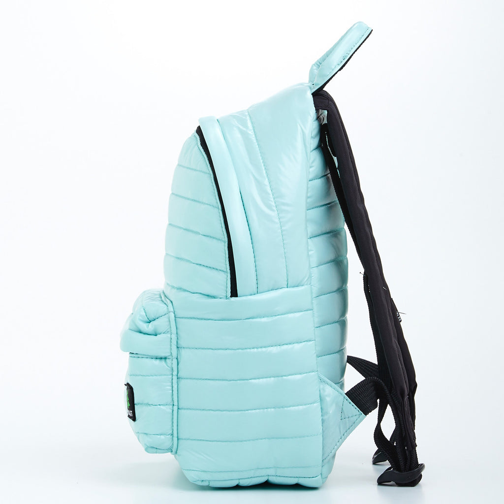 Side view of light green small backpack. Made from durable shiny nylon puffer material with quality components. Large main section and small front pocket