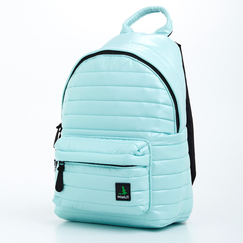 Angle front view of light green small backpack. Made from durable shiny nylon puffer material with quality components. Large main section and small front pocket