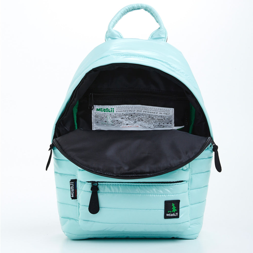 Inside view of main pocket of light green small backpack. Made from durable shiny nylon puffer material with quality components. Contrast black lining